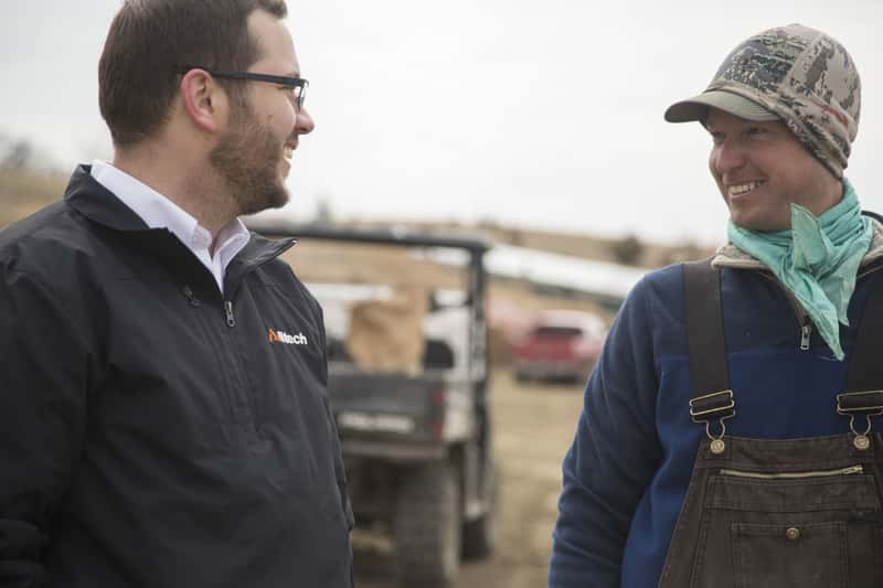 alltech sales rep with customer on-farm
