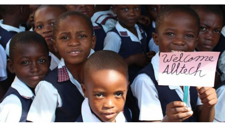 Haitian children welcome visitors to their school, which is funded through the Alltech Sustainable Haiti Program.