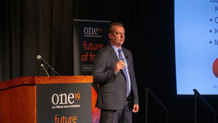 Dr. Frank Mitloehner speaking at ONE19, discussing climate change, greenhouse gases and livestock emissions