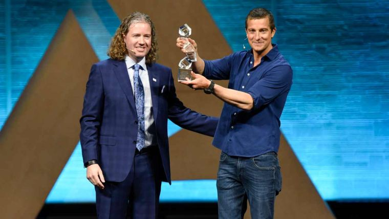 Bear Grylls accepts the Alltech Humanitarian Award from Dr. Mark Lyons