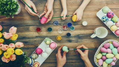 Family painting eggs.