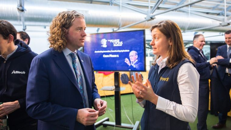 Co-founder of the ag-tech startup Breedr, Claire Lewis, speaks with Dr. Mark Lyons, president and CEO of Alltech, during the first day of The Pearse Lyons Accelerator 2019 program at Dogpatch Labs in Dublin, Ireland.