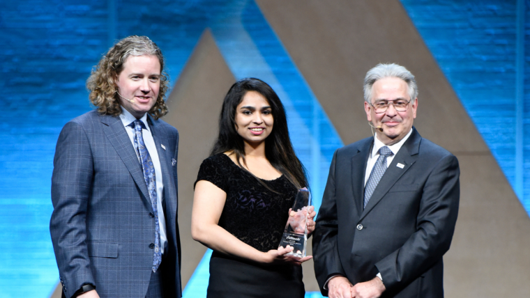 Deeksha Shetty was presented with the global award at the Alltech Young Scientist competition during ONE: The Alltech Ideas Conference (ONE19) by Dr. Mark Lyons and Dr. Karl Dawson.