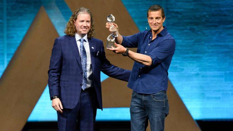 Bear Grylls accepts the Alltech Humanitarian Award from Dr. Mark Lyons